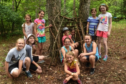 Russia cabin worked together to build a nice shelter during the Outdoor Survival skill.