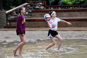 A flooded volleyball court didn't stop campers from playing Nuke 'Em.