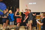 Joe invited up some campers to help him act out a story from the Bible about Peter and John.