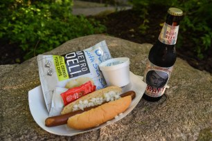 On the menu: foot-long hot dogs with various topping options, chips, artisan root beer and chocolate ice cream.