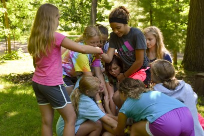 "In the team-building skill, cabins had to work together to untie a ""human knot."""