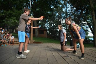 During dinner line-up, Hannah had two campers compete to see who could be the first to dissolve an Alka-Seltzer tablet (stuck to their counselors' foreheads) with a squirt gun!