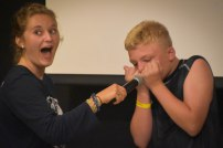 """We also gave campers the chance to come up and show everyone their """"stupid human tricks."""" This camper was """"playing the harmonica."""""""