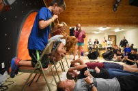 During dinner line-up, three campers competed to see who could spray the most nacho cheese into a cup on a counselor's forehead.